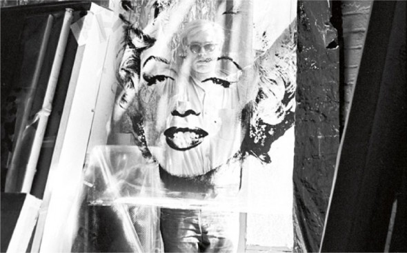 Andy Warhol with his Marilyn Monroe screen-print