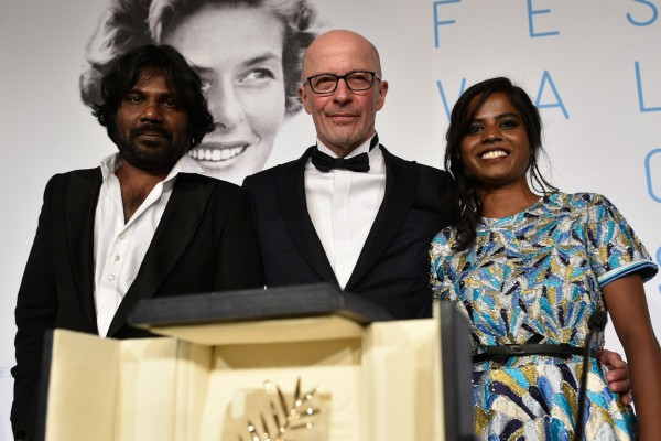 Director with of Dheepan with lead actors